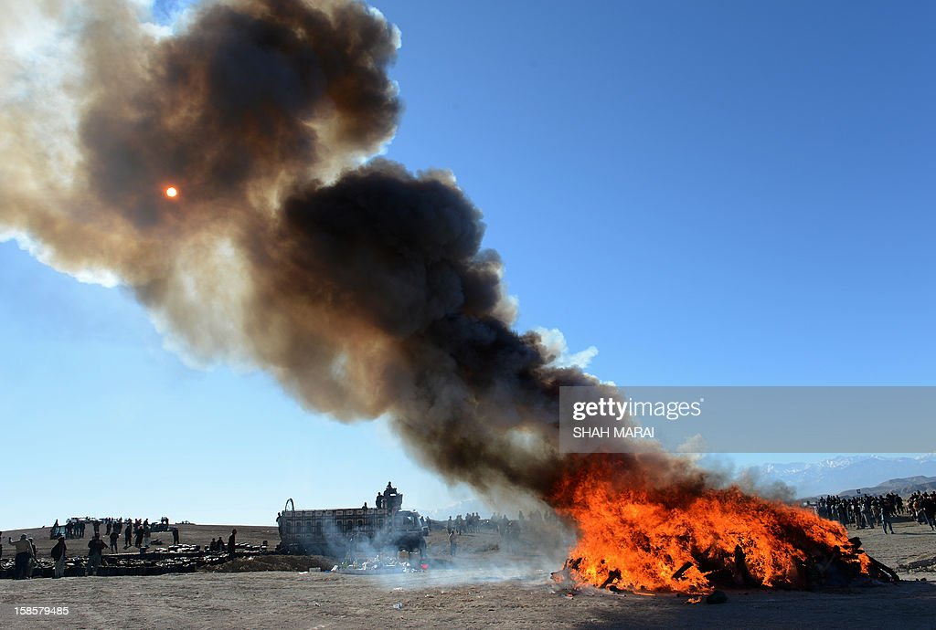 This photo taken on December 19, 2012 shows a pile of narcotics being burned by Afghan officials on the outskirts of Jalalabad Nangarhar province. The United Nations said in November that opium poppy cultivation in Afghanistan has increased by 18 percent this year, sending a 'serious alarm signal' from the world's biggest opium producer. AFP PHOTO / SHAH Marai