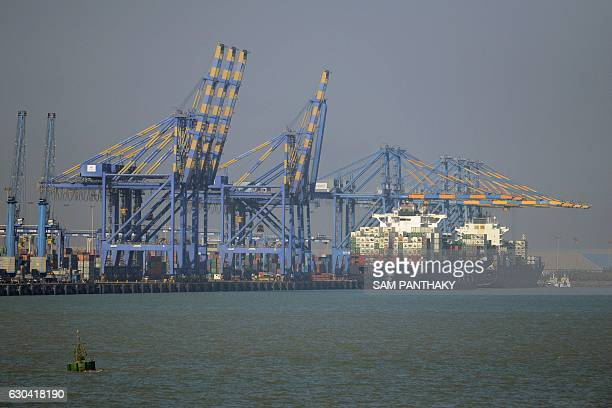 This photo taken on December 21 2016 shows a container ship docked at India's Adani Port Special Economic Zone in Mundra The Adani Port Special...