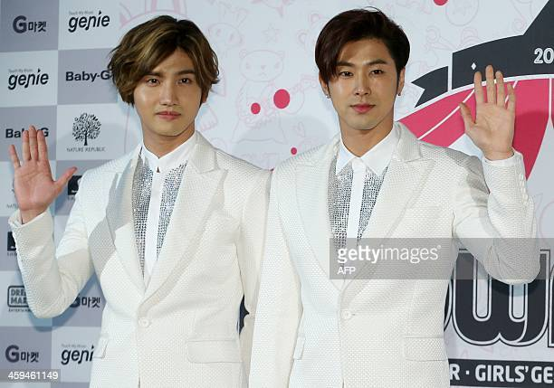 This photo taken on December 26 2013 shows South Korean idol 'TVXQ' ChangMin and YunHo posing at the press conference for their 10th year anniversary...