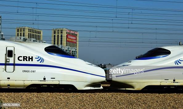 This photo taken on December 30 2014 shows highspeed trains on the railway in Hangzhou in eastern China's Zhejiang province The merger of China's top...