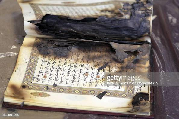 This photo taken on December 30 2015 in Ajaccio on the French Mediterranean island of Corsica shows burned copies of the Coran from an attack on a...