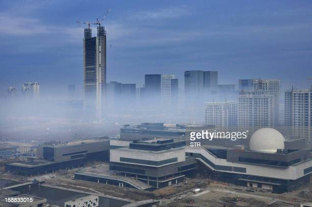 This photo taken on December 31 2012 shows the soontobecompleted highest building in Ningbo in eastern China's Zhejiang province the Global Shipping...
