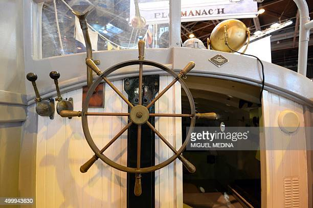 This photo taken on December 4 2015 shows the steering wheel of the former lifeboat of Ploumanac'h of the Côte d'Armor region the 'Aimee Hilda'...