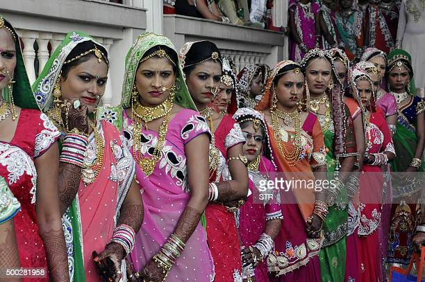 This photo taken on December 6 2015 shows brides at a massmarriage ceremony for 151 fatherless women in Surat around 265 km from Ahmedabad An Indian...
