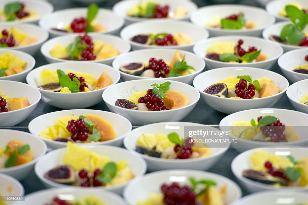 TOUITOU This photo taken on December 8 2014 shows fruit dishes at airline catering company Servair's factory at Paris' Roissy Charles de Gaulle...