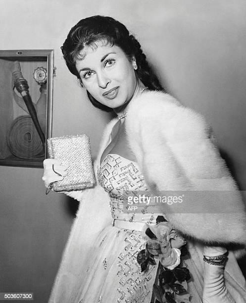 This photo taken on December 9 1953 at Milan's Scala opera house shows Italian actress Silvana Pampanini attending a performance of Alfredo...