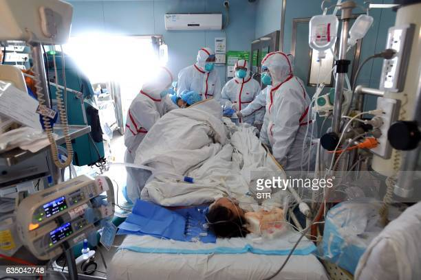 This photo taken on February 12 2017 shows an H7N9 bird flu patient being treated in a hospital in Wuhan central China's Hubei province A number of...
