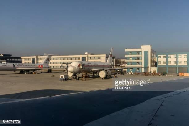 This photo taken on February 14 2017 shows a Tupolev Tu204 aircraft undergoing maintenance at Sunan Pyongyang International Airport / AFP / Ed JONES