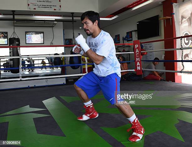 This photo taken on February 15 2016 shows Philippine boxing icon Manny Pacquiao wearing shorts and shoes with Nike logos during his training session...