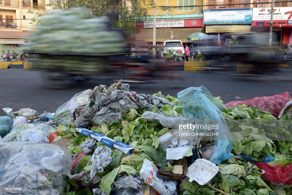 This photo taken on February 18, 2013 shows a general view of a rubbish pile along a street in Phnom Penh.