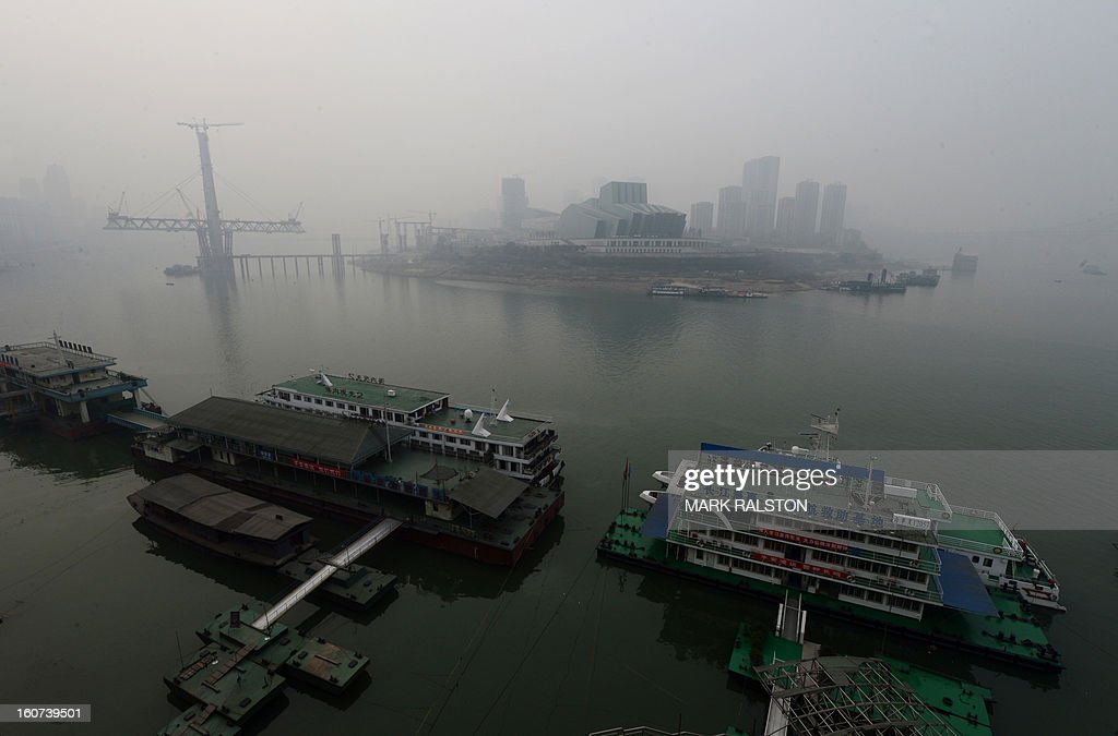 This photo taken on February 2, 2013 shows the new Grand Theatre from across the Jialing River in Chongqing. Chinese state media has reported that Chongqing under the leadership of disgraced leader Bo Xilai raked up huge debts over his popularist transport infrastructure, social housing and construction projects. The reconstruction of the city of 32 million people however made Bo a popular figure amongst locals and made the Yangtze River city one of the world's fastest-growing urban areas. AFP PHOTO/Mark RALSTON