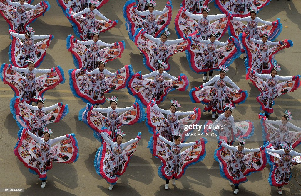 This photo taken on February 24, 2013 shows Chinese entertainers performing a dance during the traditional Lantern Festival parade which falls on the 15th day of the Lunar New Year, which officially ends its celebrations, in Yuxian. The festival which dates back more than 2000 years to the Han Dynasty sees China's cities become a sea of lanterns and fireworks. AFP PHOTO/Mark RALSTON