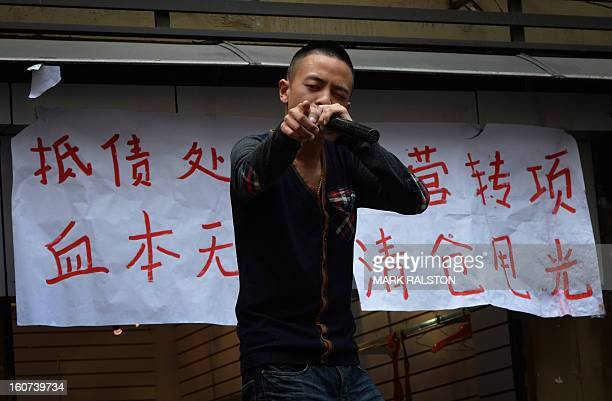 This photo taken on February 3 2013 shows a Chinese salesman touting for business in the Jiafeng Bei shopping area in Chongqing Chinese state media...