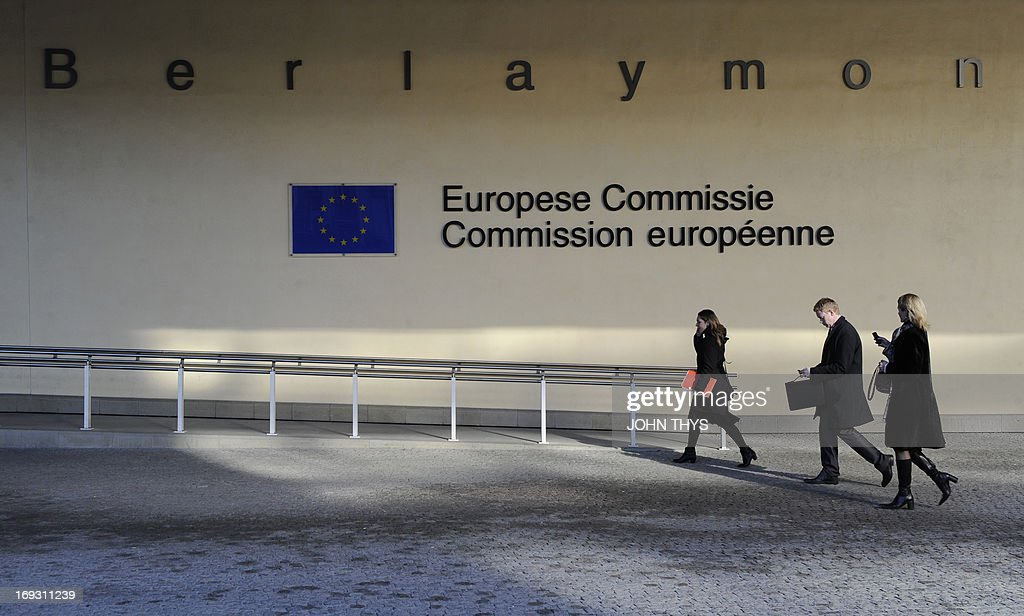 This photo taken on February 8, 2011 shows people walking in front of the European Union Commission building at the EU Headquarters in Brussels.