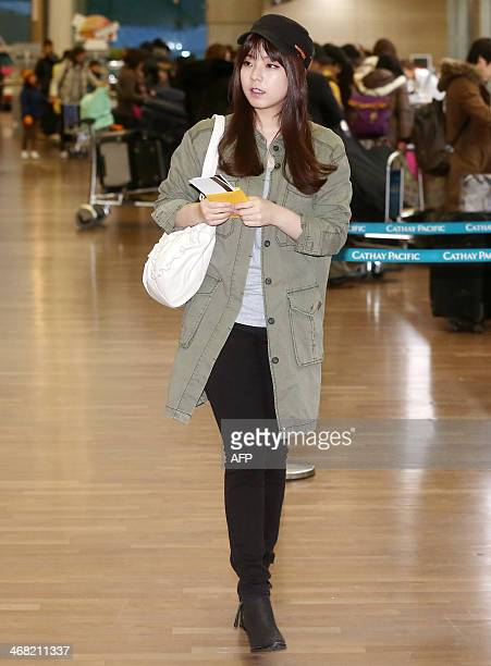 This photo taken on February 9 2014 shows South Korean singer Juniel departing from Incheon International Airport to attend a fan signing event in...