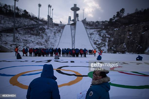 This photo taken on February 9 2015 shows participants rehearsing in the ski jump field for a performance event marking the threeyear countdown to...