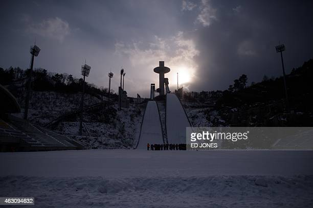 This photo taken on February 9 2015 shows participants waiting in the ski jump field before a performance event marking the threeyear countdown to...