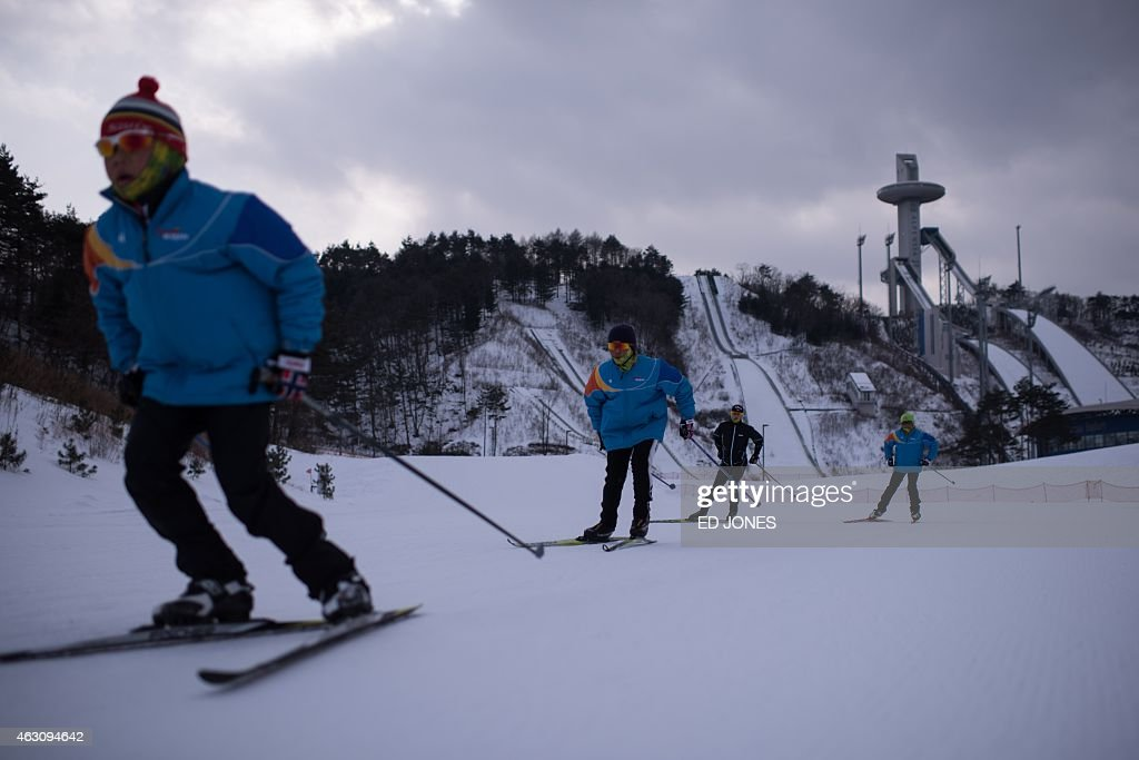 This photo taken on February 9 2015 shows skiers on a course at the Alpensia resort in Pyeongchang The Pyeongchang 2018 Winter Olympics will be held...