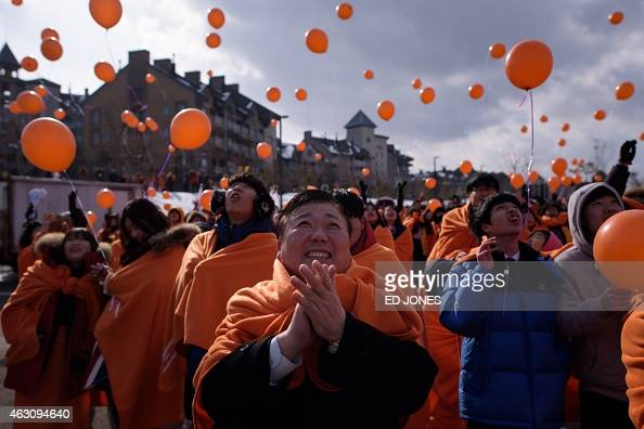 This photo taken on February 9 2015 shows students attending a balloon launching event to mark a threeyear countdown to the Pyeongchang 2018 Winter...