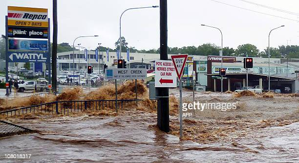 This photo taken on January 10 2011 shows flash floods described as an 'inland tsunami' smashing through mountainside Toowoomba sweeping away entire...