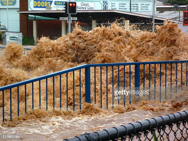 This photo taken on January 10 2011 shows flood waters surging through streets inundating the city of Toowoomba Australia braced for a rapidly rising...