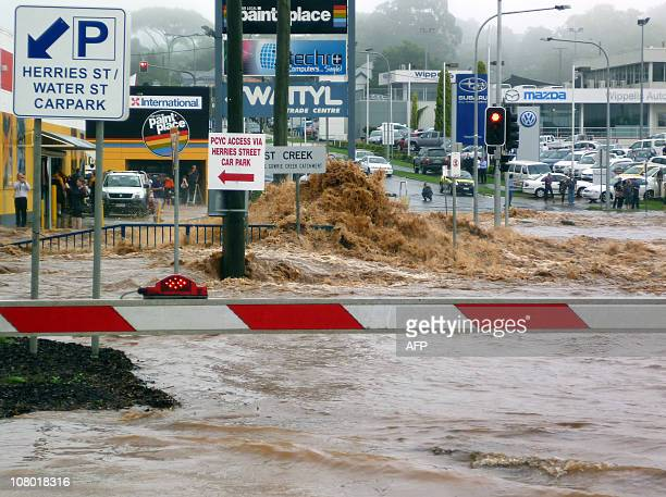 This photo taken on January 10 2011 shows the appropriately named Water Street being submerged by flash floods described as an 'inland tsunami'...