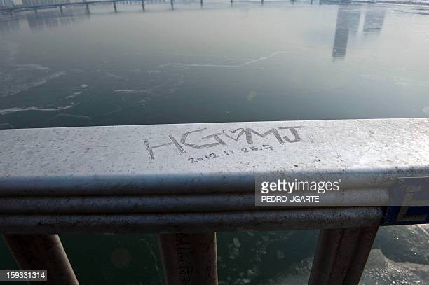 This photo taken on January 11 2013 shows a love message scrawled on Mapo Bridge a common site for suicides over Seoul's Han river The South Korean...