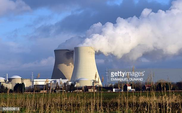 This photo taken on January 12 2016 shows the cooling towers of Belgium's Doel nuclear plant belching thick white steam They are part of a...