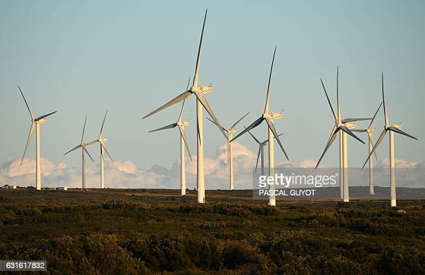 This photo taken on January 13 2017 near Villeveyrac southern France shows wind turbines / AFP / PASCAL GUYOT