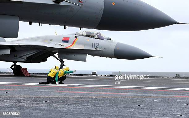 This photo taken on January 2 2017 shows Chinese J15 fighter jets on the deck of the Liaoning aircraft carrier during military drills in the South...