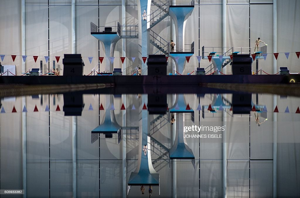 TOPSHOT This photo taken on January 20 2016 in Shanghai shows a member of the Chinese national Diving team jumping of the 10m platform during a...