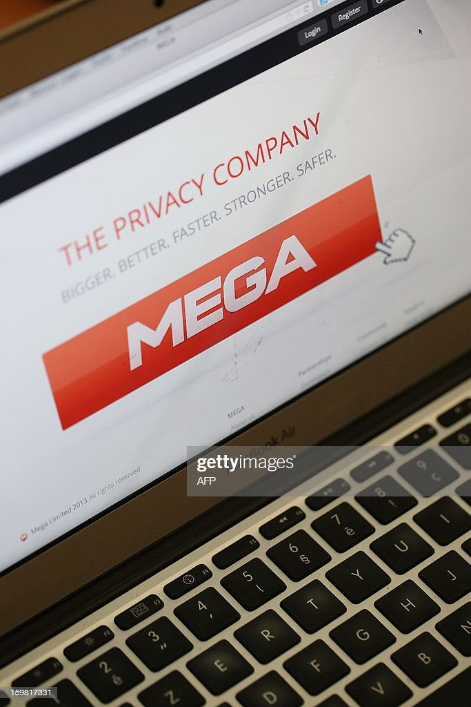 This photo taken on January 21, 2013, in Paris, shows a computer screen with the home page of the new 'Mega' website launched by controversial 'Megaupload' founder Kim Dotcom. Megaupload founder Kim Dotcom hailed a 'massive' response on January 20 to his new file-sharing service with half a million users registering within hours, a year after his arrest in the world's biggest online piracy case. The mega.co.nz website, which replaces the outlawed Megaupload, went live at dawn ahead of a lavish evening party at the New Zealand-based Internet tycoon's Auckland mansion, on the anniversary of the armed police raid that saw him arrested and the site shuttered. AFP PHOTO / THOMAS SAMSON