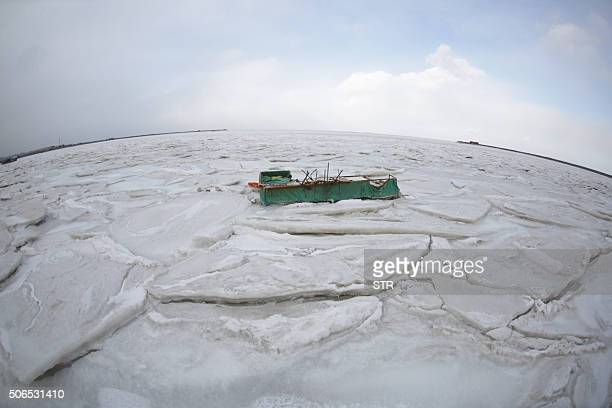 This photo taken on January 23 2016 shows coastal waters frozen in Dalian in northeast China's Liaoning province Much of China shivered on January 23...