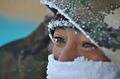 This photo taken on January 23 2016 shows ice forming on an armed policeman's face on a street in the city of Hulun Buir in northern China's Inner...