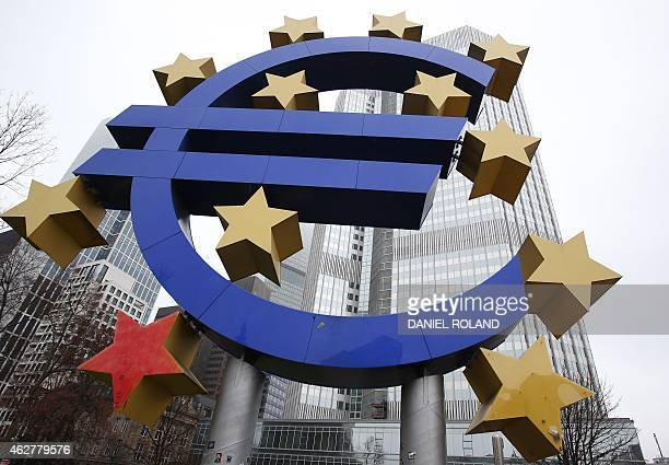 This photo taken on January 26 2015 shows the euro sign sculpture in front of the building that used to host the headquarters of the European Central...