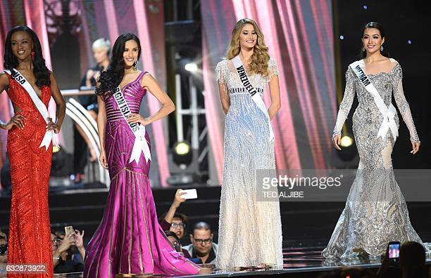 This photo taken on January 26 2017 shows Miss Universe contestant Le Hang of Vietnam in her long gown along with other candidates during the...