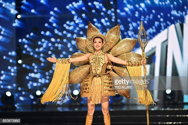 This photo taken on January 26 2017 shows Miss Universe contestant Le Hang of Vietnam presents during the national costume and preliminary...