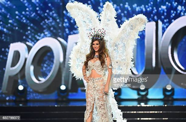 This photo taken on January 26 2017 shows Miss Universe contestant Flavia Brito of Portugal during the national costume presentation in the...