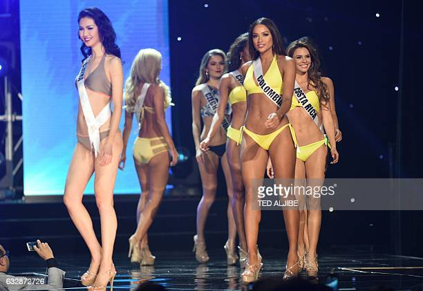 This photo taken on January 26 2017 shows Miss Universe contestant Andrea Tovar of Colombia in her siwmsuit along with other candidates during the...