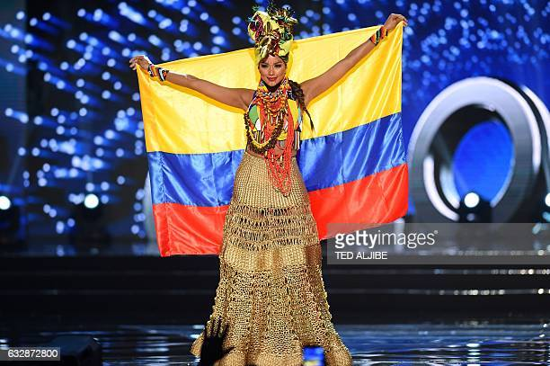 This photo taken on January 26 2017 shows Miss Universe contestant Andrea Tovar of Colombia presents during the national costume and preliminary...