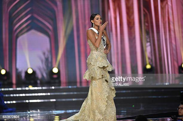 This photo taken on January 26 2017 shows Miss Universe contestant Andrea Tovar of Colombia in her long gown during the preliminary competition of...