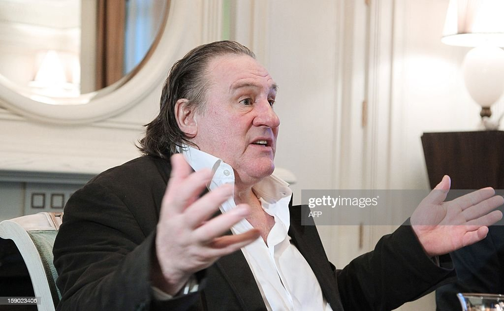 This photo taken on January 5, 2013 shows French actor Gerard Depardieu gesturing as he speaks to Russian President Vladimir Putin during their meeting at Putin's residence in Sochi. Depardieu has received a Russian passport, Putin's spokesman said on January 6. AFP PHOTO / RIA-NOVOSTI / MIKHAIL KLIMENTYEV