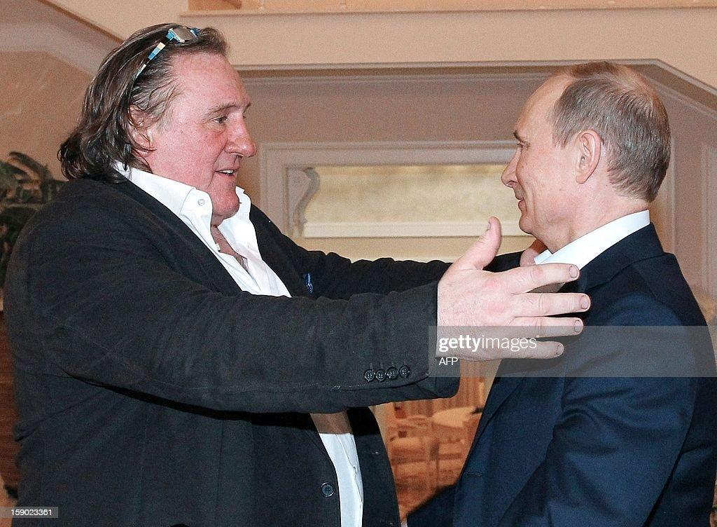 This photo taken on January 5, 2013 shows Russian President Vladimir Putin (R) greeting French actor Gerard Depardieu during their meeting in Putin's residence in Sochi. Depardieu has received a Russian passport, Putin's spokesman said on January 6.