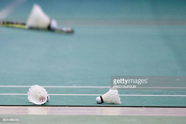 This photo taken on January 6 2016 shows shuttlecocks scattered across the court during a training session with the Beijing Badminton team in Beijing...