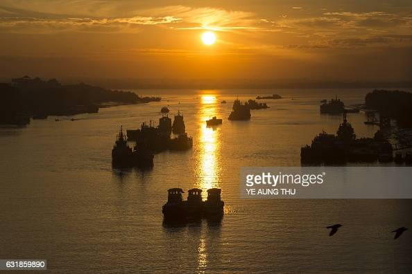 TOPSHOT This photo taken on January 8 2017 shows boats on the Yangon river during sunrise in Yangon / AFP / Ye Aung THU