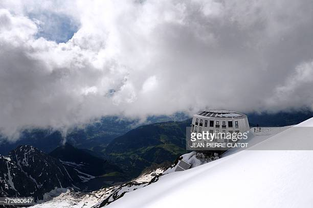 AGASSE This photo taken on July 1 2013 in the mountains of MontBlanc eastern France shows the newlyopened Gouter mountain hut Ultramodern and...