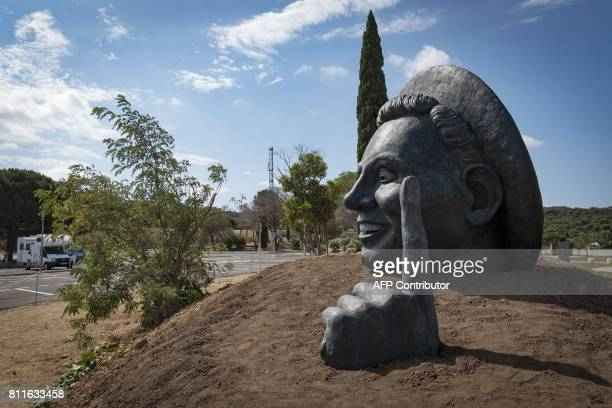 This photo taken on July 10 2017 show a sculpture by artist Thierry Delorme of French singer from Narbonne Charles Trenet installed at a rest stop on...
