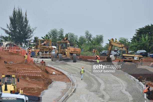 This photo taken on July 11 2015 shows a road construction site in the Riviera residential neighborhood of Abidjan AFP PHOTO / ISSOUF SANOGO