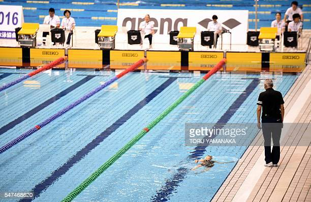 This photo taken on July 14 2016 shows 101yearold Mieko Nagaoka swimming alone after the other competitors in the women's 400m freestyle race in the...