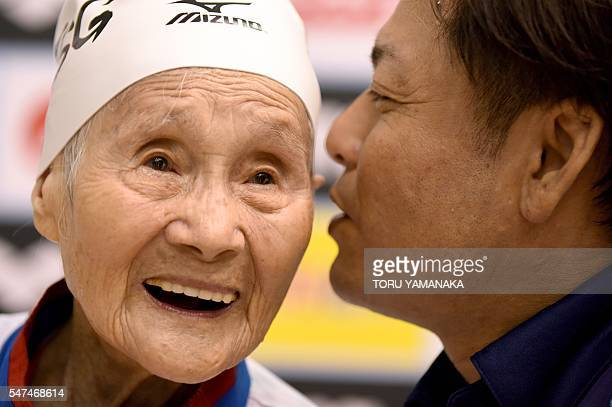 This photo taken on July 14 2016 shows 101yearold Mieko Nagaoka listening to her coach Shintaro Sawada repeat a question for reporters at the...